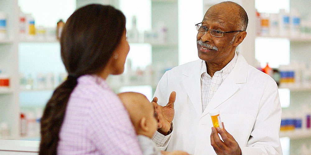 physician talking to customer about prescription